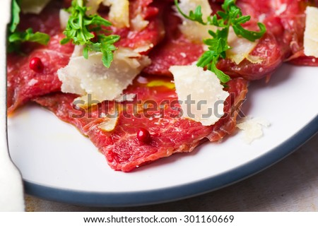 carpaccio from veal. traditional Italian appetaizer. selective focus - stock photo