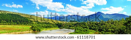 Carpathian mountain summer landscape with river, sky and clouds - stock photo
