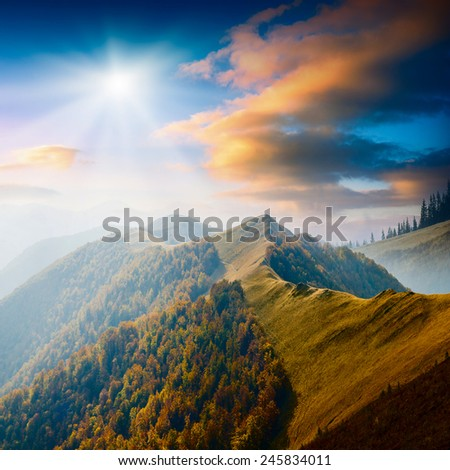 Carpathian mountain valley with colorful clouds in a sunset light. Majestic landscape - stock photo