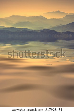 Carpathian mountains in a sunset light, reflected in water of mountain lake - stock photo