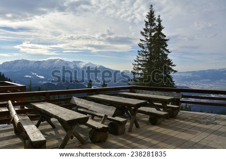 Carpathian Mountains in winter. View from terrace on Postavarul cottage  - stock photo