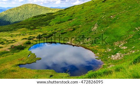 Carpathian mountains landscape, view from the height, Nesamovyte lake under hill