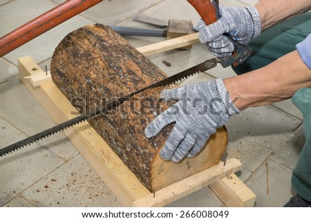 Carpenter begins to manufacture birdhouse  from log - stock photo
