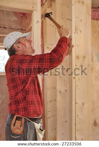 Carpenter building interior partition - stock photo