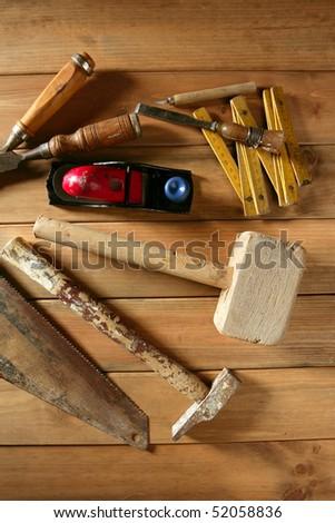 carpenter craftsman hand tools saw hammer wood tape plane gouge - stock photo