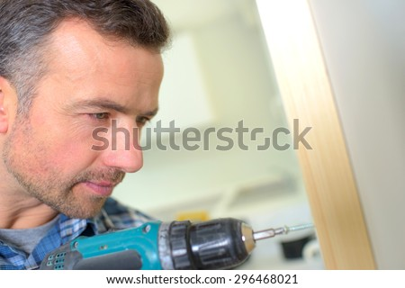 Carpenter drilling - stock photo