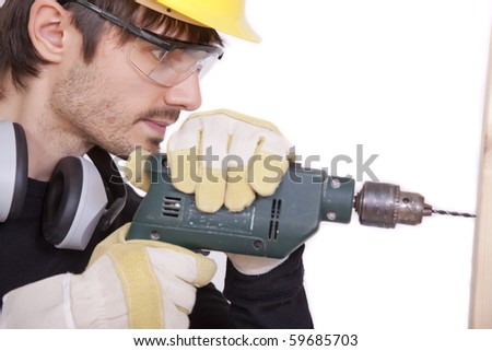 carpenter drilling in woods - isolated on white background - stock photo