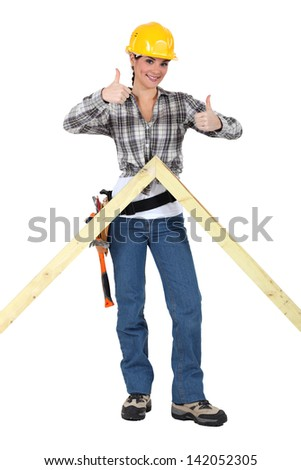 Carpenter giving two thumb's up - stock photo