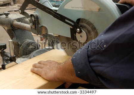 carpenter hand and  saw in time of  work - stock photo