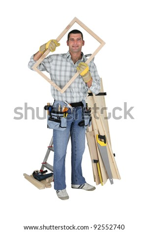 Carpenter holding wooden frame