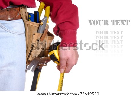 Carpenter in tool belt closeup holds measure tape over white background