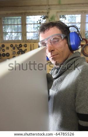 Carpenter in workshop - stock photo