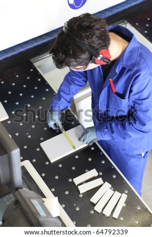 Carpenter in workshop - stock photo