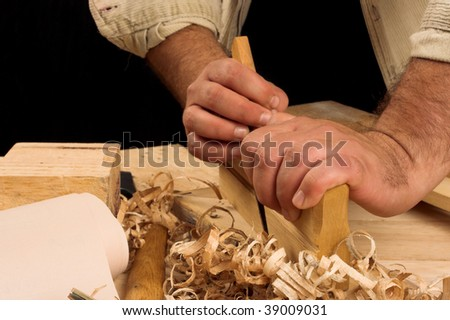 carpenter's hands - working with plane