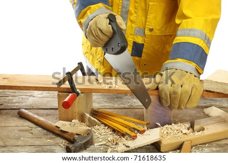 carpenter's hands - working with saw