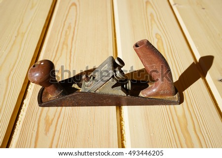 carpenter's plane on a wooden planks