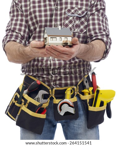 Carpenter showing a house model - stock photo