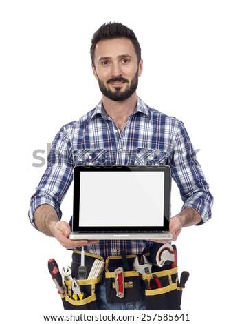 Carpenter showing laptop - stock photo