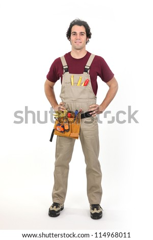 Carpenter stood with his hands on his hips - stock photo