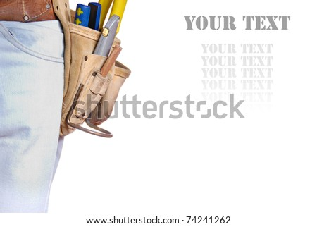 Carpenter tool belt closeup with copy-space - stock photo