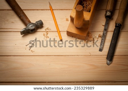 carpenter tools in pine wood table top view - stock photo