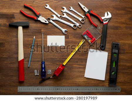 carpenter tools in pine wood table top view