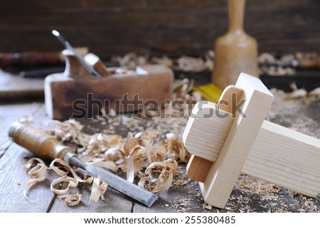 Carpenter tools on a work bench carpentry. - stock photo