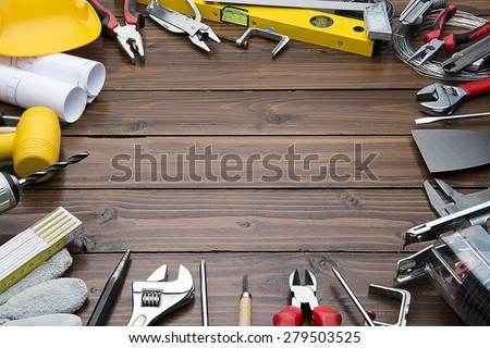 Carpenter Tools on Chestnut Wood Background. Blueprints are not subject to copyright. Words on them are regular like kitchen, bedroom, bathroom etc. - stock photo