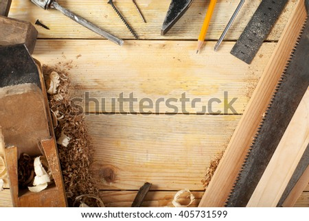 Carpenter tools on wood table background. Copy space. Top view. - stock photo