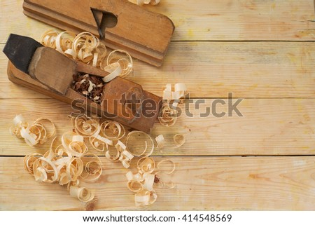 Carpenter tools on wood table background. Top view. Copy space.