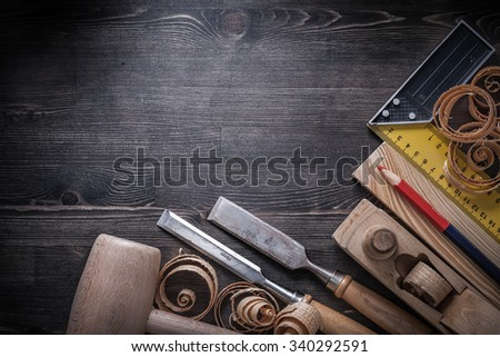 Carpenter tools on wooden board construction concept. - stock photo