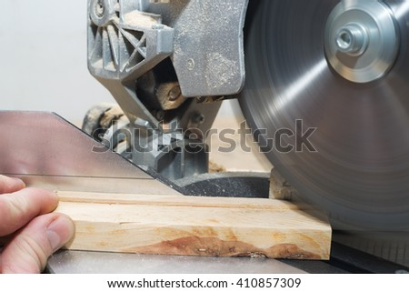 Carpenter tools on wooden table with sawdust. Circular Saw. Cutting a wooden plank. Copy space.
