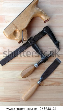 Carpenter Tools Planes, G-clamp and Chisels for Woodworking - stock photo