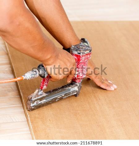 carpenter use air-gun for make new furniture  - stock photo