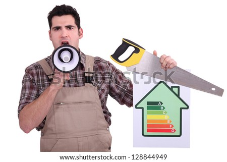 Carpenter with an energy rating sign - stock photo