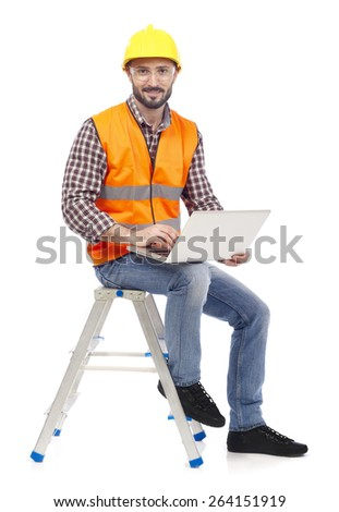 Carpenter with laptop - stock photo