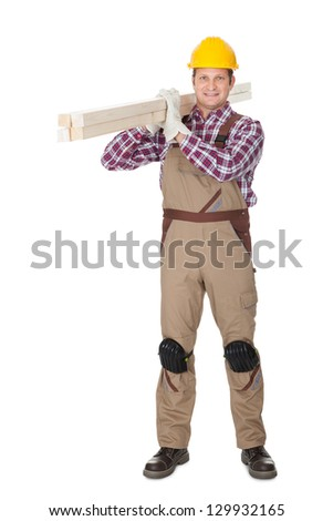 Carpenter with wooden planks. Isolated on white background - stock photo