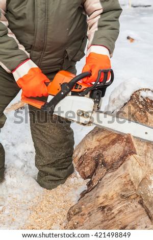 Carpenter working at sawmill  - stock photo