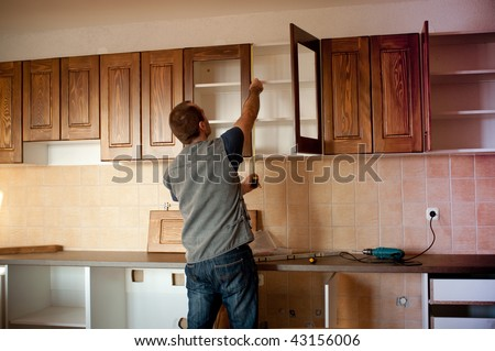 Remodel stock images royalty free images vectors for Carpenter for kitchen cabinets