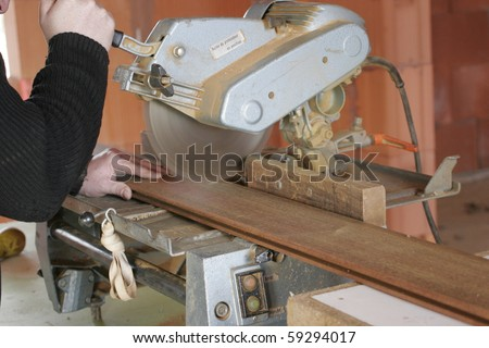 carpenter working with a saw
