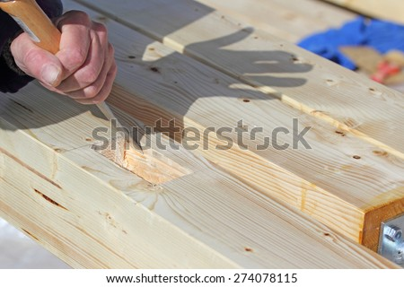 Carpenter working with chisel - stock photo