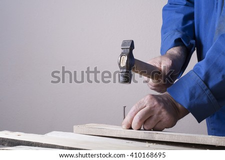 Carpenter working with plane on wooden background at Building Site. Carpenter workplace - stock photo