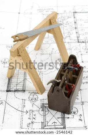 Carpenters tools on blueprints. - stock photo