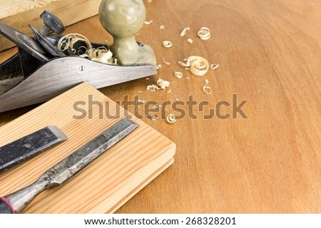 Carpenters working tools: plane and chisels with planks and shavings - stock photo