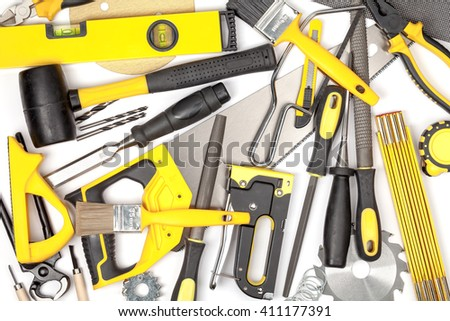 carpentry and woodwork tools on white background. carpenter working table. creative mess composition in yellow colors top view - stock photo