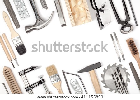 carpentry and woodwork tools on white background. carpenter working table. frame composition with copy space top view