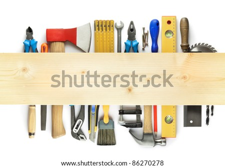 Carpentry background. Tools underneath the wood plank. - stock photo