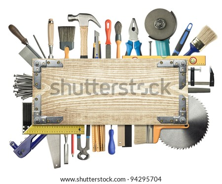 Carpentry, construction background. Tools underneath the wood plank. - stock photo