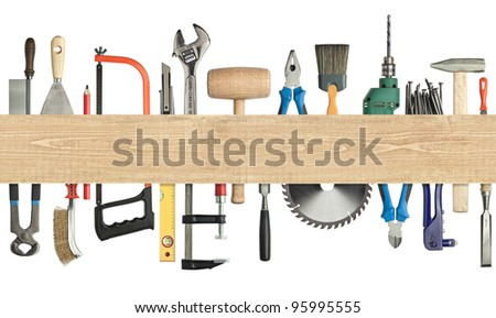Carpentry, construction background. Tools underneath the wood plank. Image has seamless edges. - stock photo