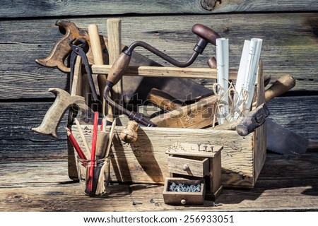 Carpentry tools and diagrams in an old workshop - stock photo